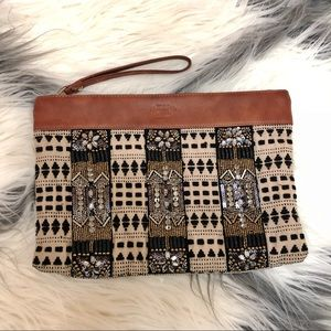 Leather and beaded tribal clutch